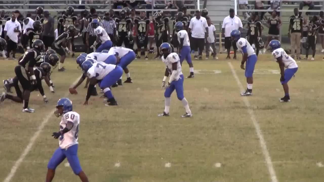 Eric Barton Playing Football For Manassas High School In - Mitchell high school memphis tn
